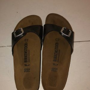 Black Birkenstocks one strap.